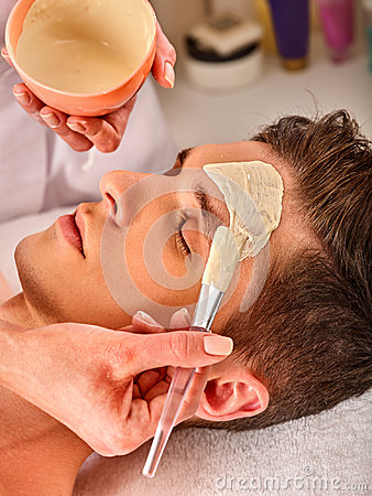Free Mud Facial Mask Of Man In Spa Salon. Face Massage. Royalty Free Stock Image - 97202366