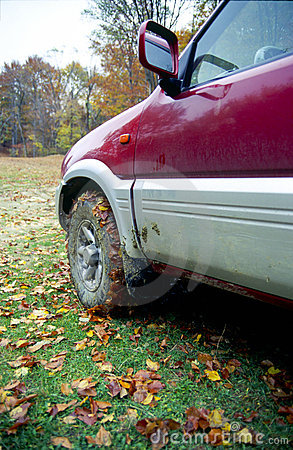 Muddy car in autumn