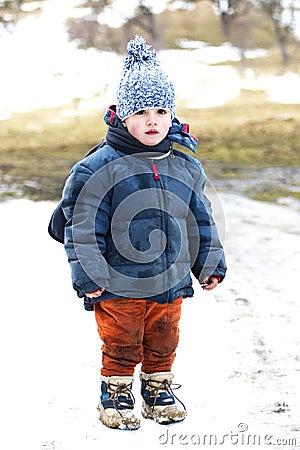 Muddy child in snow