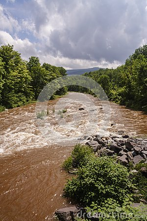 Free Muddy Creek After Heavy Rainfall Stock Photo - 126816060