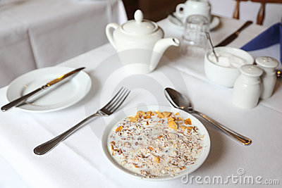 Muesli in bowl of milk on table