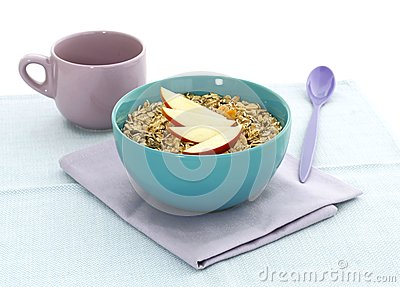 Muesli of oats and apple in bowl