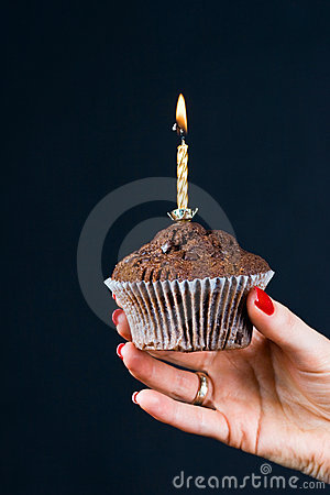 Muffin with a candle