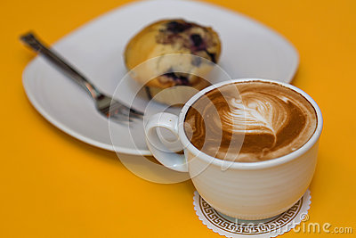 Muffin and coffee latte