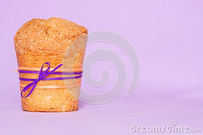 Muffin with purple ribbon