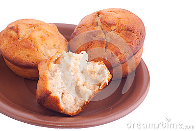 Muffins on brown saucer