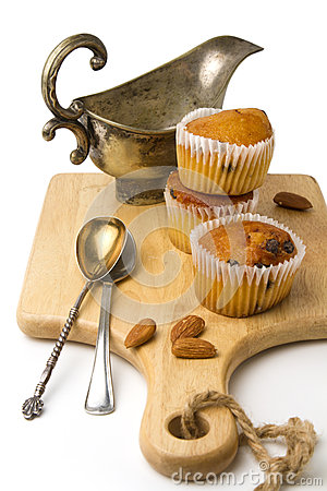 Muffins on wooden cutting board