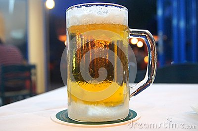 Mug of cold beer from the frost