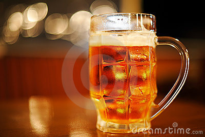 Mug of cold light golden beer