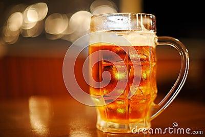 Mug of cold light golden beer