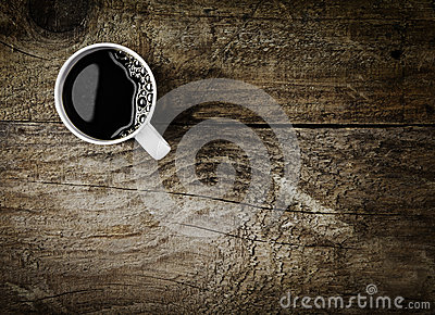 Mug of espresso coffee on rustic wood