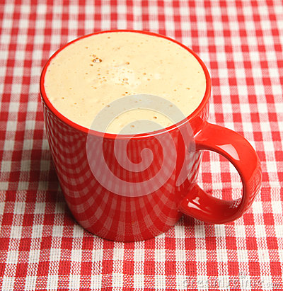 Mug of Frothy Coffee