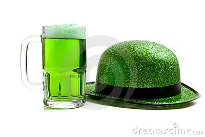 Mug of green beer and green glitter hat on white