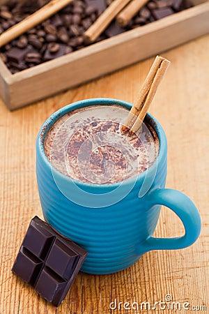 Mug of hot chocolate with cinnamon