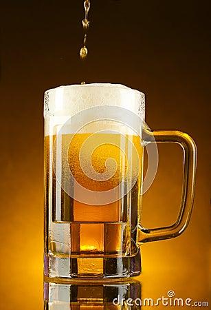 Free Mug Of Beer On  Yellow Stock Photo - 21056760