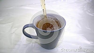 Mug of tea filled in slow motion