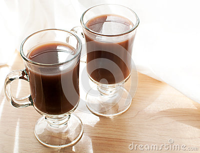 Mugs with cocoa drink
