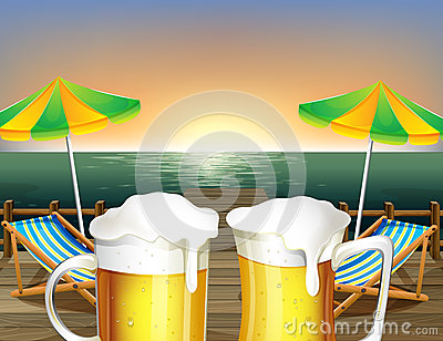 Mugs of cold beer at the beach