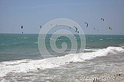 Kite surfers kite surfing at Mui Ne, Vietnam Editorial Stock Image