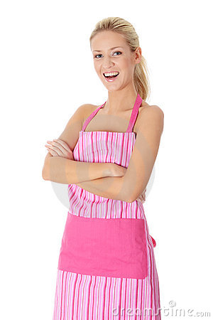 Mujer desnuda rubia feliz en delantal rosado