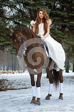 Mujer en un caballo