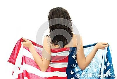 Mujer triguena desnuda que desgasta un indicador americano