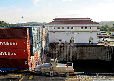 Mule Guiding Container Ship Editorial Stock Photo