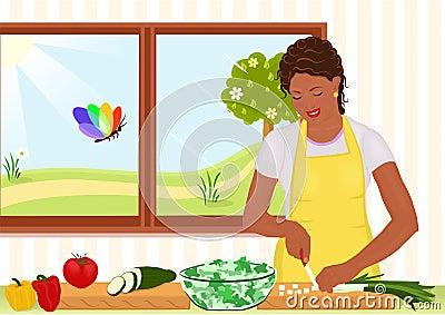 Mulher bonita do americano africano que prepara a salada