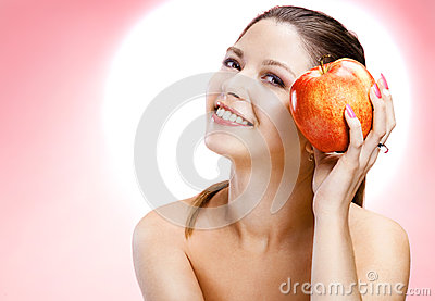 Muliebrity woman with apple