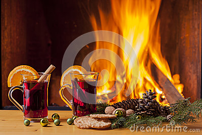 Mulled wine and cookies at christmas fireplace