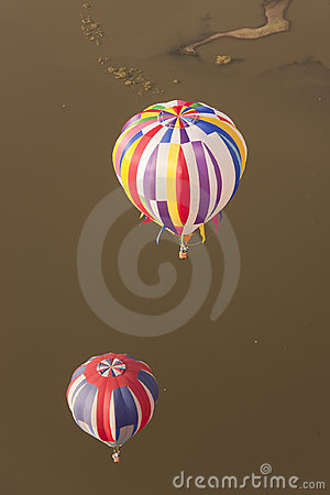 Multi color hot air balloons in flight