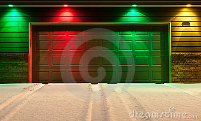 Multi-Colored Garage Door and Snowy Driveway