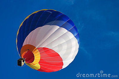 Multi colored hot air balloon on a blue sky 1