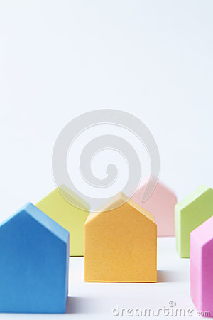 Multi Colored House Shaped Blocks On White Background