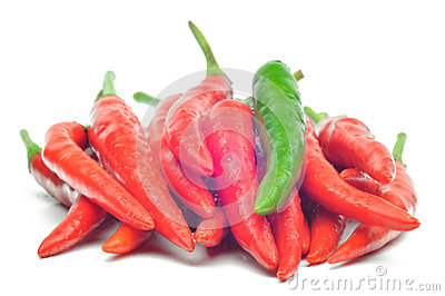 Multi-colored peppers on a white background