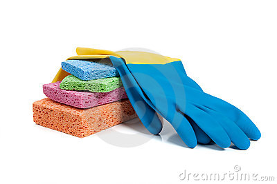 Multi-colored sponges and rubber gloves on white