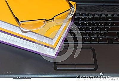 Multi-coloured books and glasses.