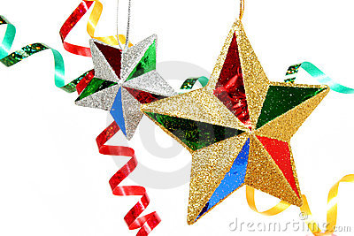 Multi-coloured celebratory tinsel and two christmas stars