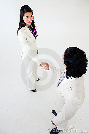 Multi-ethnic business people closing a deal