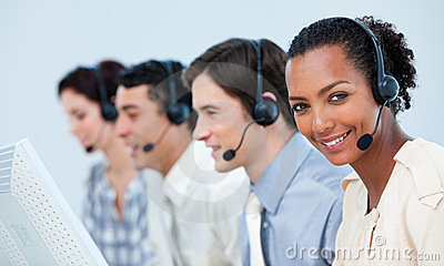 Multi-ethnic business people using headset