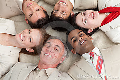 Multi-ethnic business team lying in a circle