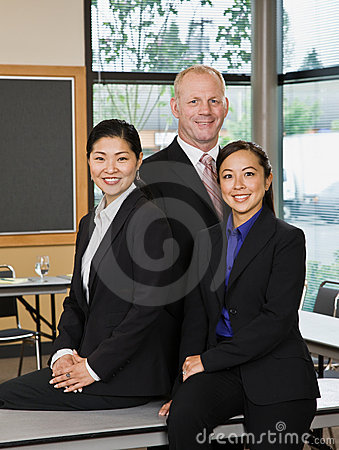 Multi-ethnic co-workers in conference room