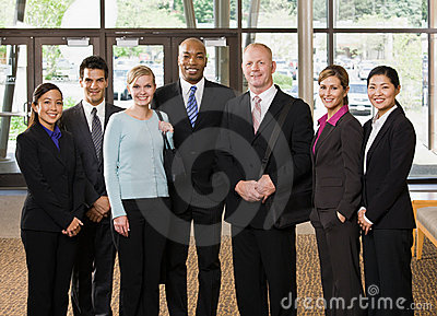 Multi-ethnic co-workers posing in lobby