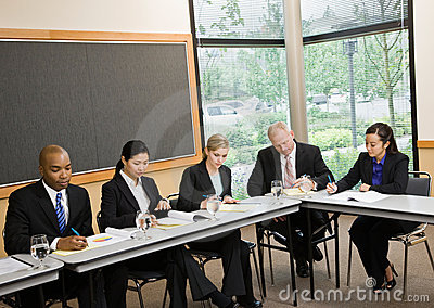 Multi-ethnic co-workers sitting around table