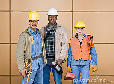 Multi-ethnic construction workers posing