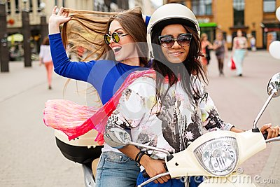 multi ethnic girls on a scooter stock photo   image 41401363