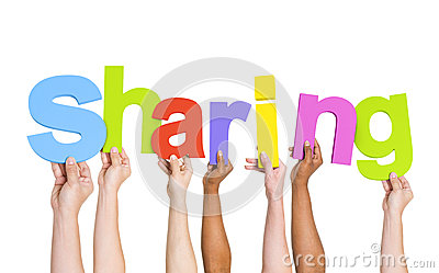 multi ethnic hands holding the word sharing stock photo