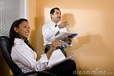 Multi-ethnic office workers watching presentation