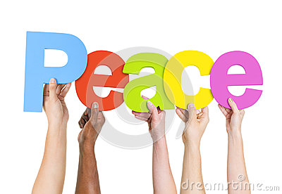 Multi Ethnic People Holding The Word Peace