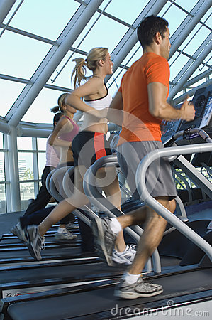 Multi Ethnic People Running On Treadmill